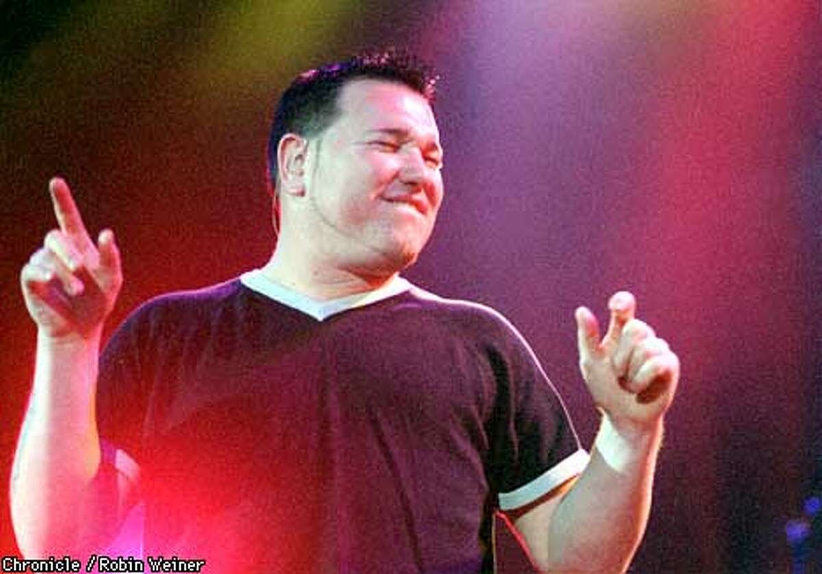 Smashmouth vocalist Steve Harwell jams during the opening songs at the Bill Graham Civic Auditorium in San Francisco. BY ROBIN WEINER/THE CHRONICLE