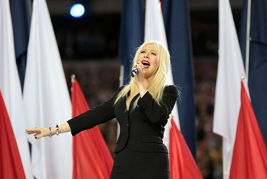 ARLINGTON, TX - FEBRUARY 06:  Singer Christina Aguilera sings the National Anthem during Super Bowl XLV between the Pittsburgh Steelers and the Green Bay Packers at Cowboys Stadium on February 6, 2011 in Arlington, Texas.  (Photo by Jamie Squire/Getty Images) Photo: Jamie Squire, Getty Images