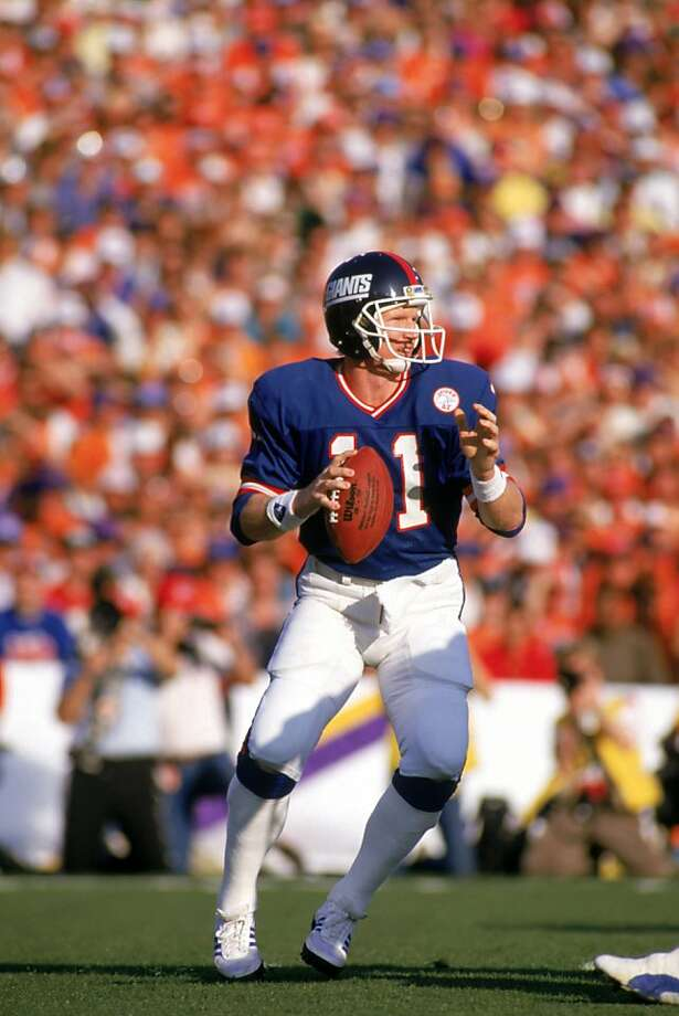 PASADENA, CA - JANUARY 25:  Quarterback Phil Simms #11 of the New York Giants drops back to pass against the Denver Broncos during Super Bowl XXI at the Rose Bowl on January 25, 1987 in Pasadena, California. The Giants defeated the Broncos 39-20. (Photo by George Rose/Getty Images) Photo: George Rose, Getty Images