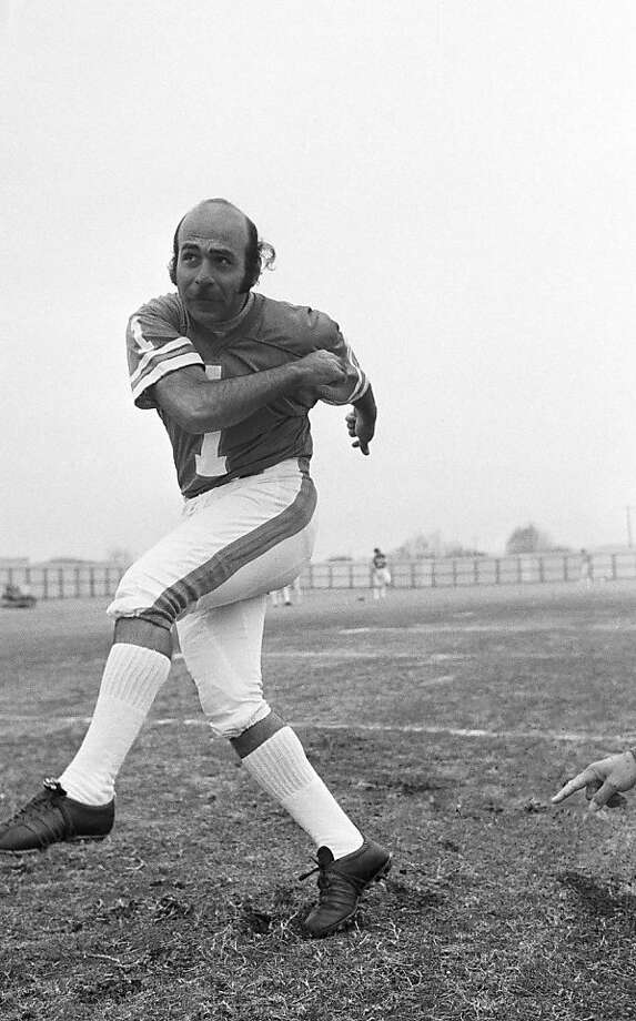 Garo Yepremian, Miami Dolphins place kicker, watches as the ball heads toward the crossbar during a workout for the Super Bowl game with Minnesota Vikings in Houston, Jan. 9, 1974. The soccer-type kicker could mean the difference between winning and defeat for the Dolphins. (AP Photo) Photo: Anonymous