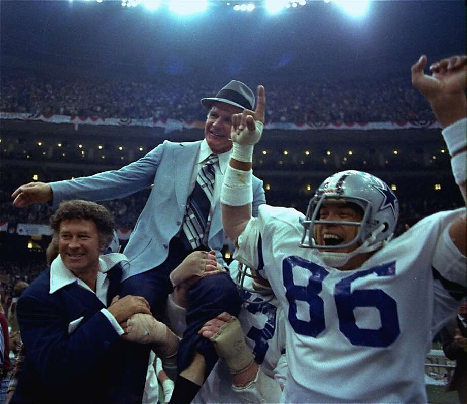 Dallas Cowboys' head coach Tom Landry is given a victory ride on the shoulders of his players after the Cowboys defeated the Broncos 27-10 in Super Bowl XII at the New Orleans Louisiana Super Dome on Jan. 15, 1978. (AP Photo)