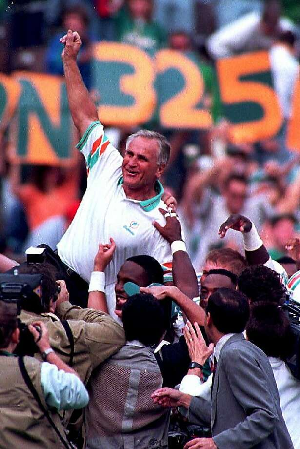 PHILADELPHIA, :  Miami Dolphins head coach Don Shula gets carried of the field by his players 14 November 1993, in Philadelphia, PA, after beating the Philadelphia Eagles 19-14. The win was Shula's 325th in his career making him the winningest coach in National Football League history. (Photo credit should read JEFF HAYNES/AFP/Getty Images) Photo: Jeff Haynes