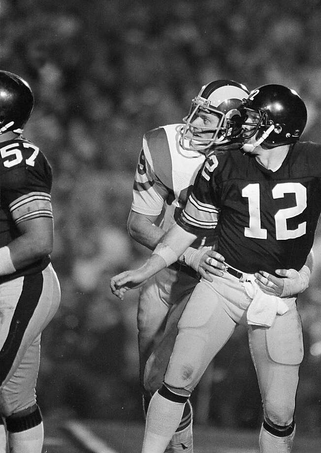 Pittsburgh Steelers' quarterback Terry Bradshaw (12), and Los Angeles Rams defender Bob Brudzinski, watch the pass Bradshaw threw during the fourth quarter of Super Bowl XIV, Jan. 20, 1980, in the Rose Bowl in Pasadena.  (AP Photo/Pete Leabo) Photo: Pete Leabo