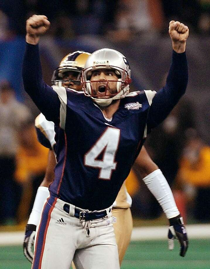 NEW ORLEANS, UNITED STATES:  New England Patriots kicker Adam Vinatieri celebrates his game-winning field goal in the second half 03 February, 2002 of Super Bowl XXXVI in New Orleans, Louisiana. The Patriots defeated the St. Louis Rams 20-17 for the NFL championship. AFP PHOTO/Stan HONDA (Photo credit should read STAN HONDA/AFP/Getty Images) Photo: Stan Honda
