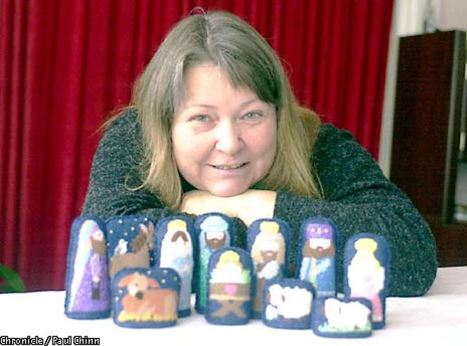 Czech master seamstress Nadia Dvorak embroidered a nativity scene for the holiday season. Dvorak is hoping for support herself and her three children from the Season of Sharing program.  PAUL CHINN/S.F. CHRONICLE Photo: PAUL CHINN