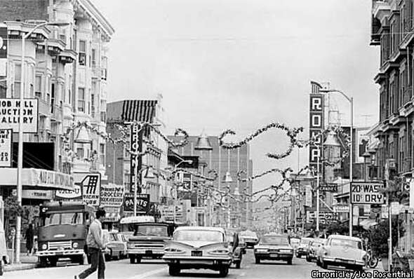 Polk Street Christmas decorations between Sacramento and California Streets in 1966. CHRONICLE PHOTO BY JOE ROSENTHAL/1966