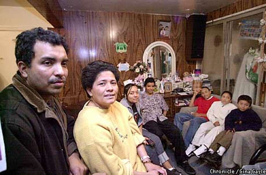 The Centeno family of seven share a small one baedroom apartment. From left, Fransisco, Ivania, Carolina,18, Marlon,14, Manuel,15, Ana,11 and Roger,7. Photo by Gina Gayle/The SF Chronicle. Photo: GINA GAYLE