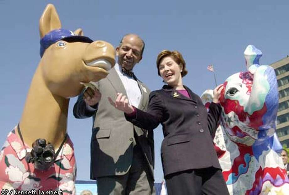 Washington Mayor Anthony Williams and first lady Laura Bush looked over a painted donkey. Associated Press photo by Kenneth Lambert