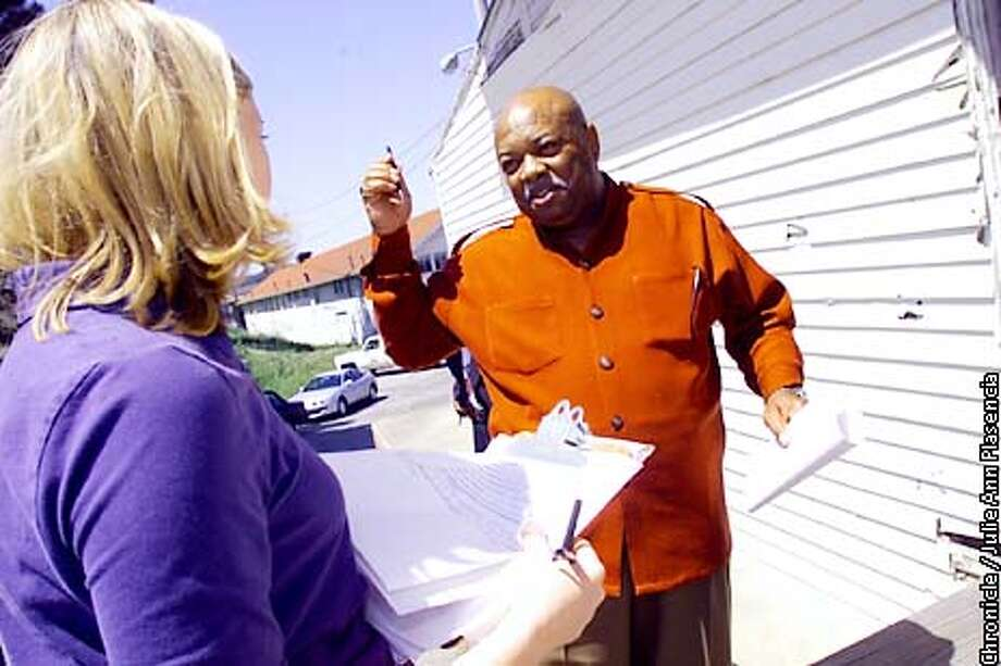 Presidio Trust employees James Newman (government employee since 1967) speaks with Laborers International Union of North America representative Erin Ferguson. Presidio Trust laid off of 62 people last week. SFC/JULIE PLASENCIA Photo: FREDERIC LARSON