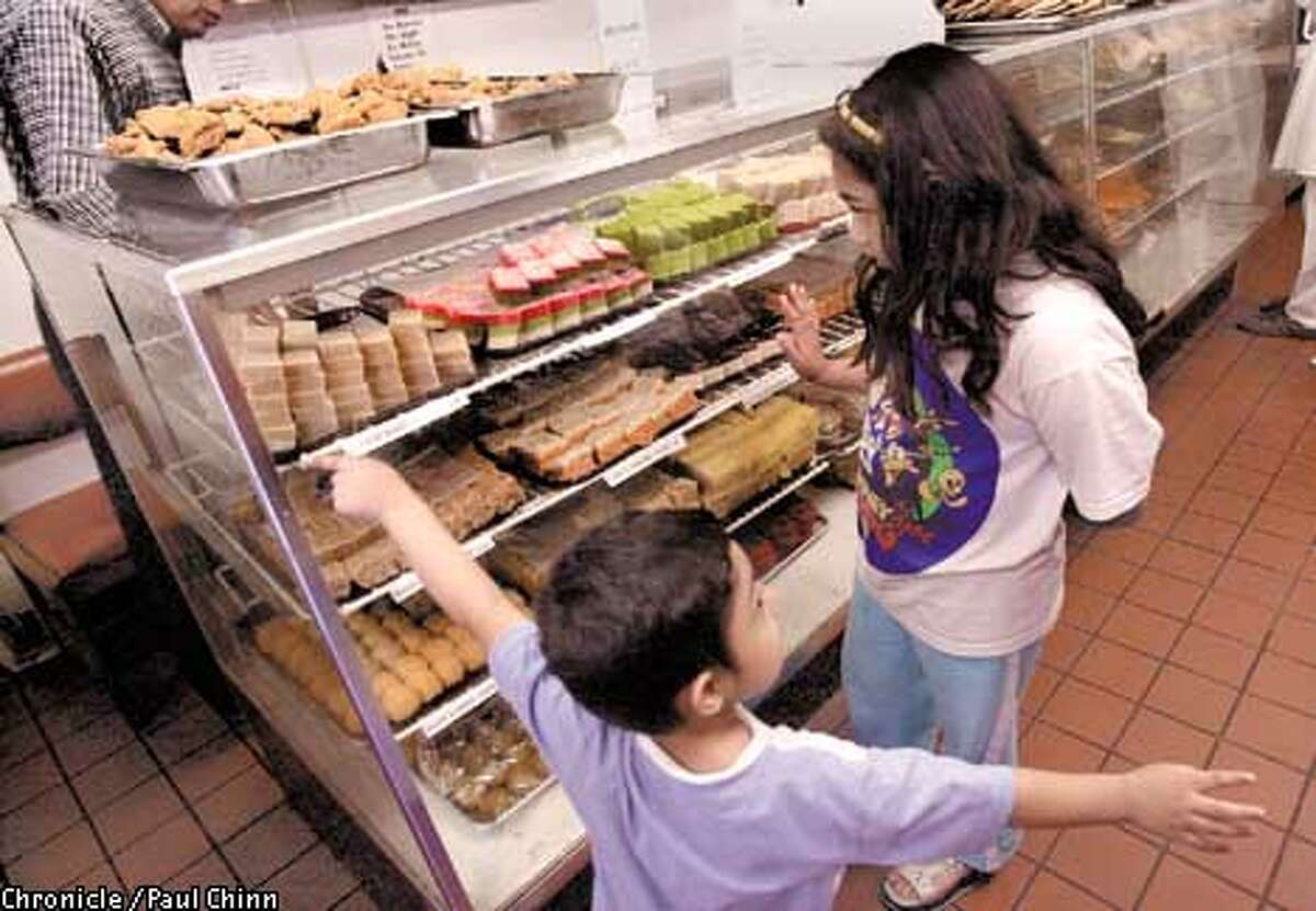 Saquiba Tariq (right) and her brother Hannan admired the Barfee sweet pastries at Bharat Bazaar in Santa Clara which is the granddaddy of Indian markets in the South Bay. PAUL CHINN/S.F. CHRONICLE
