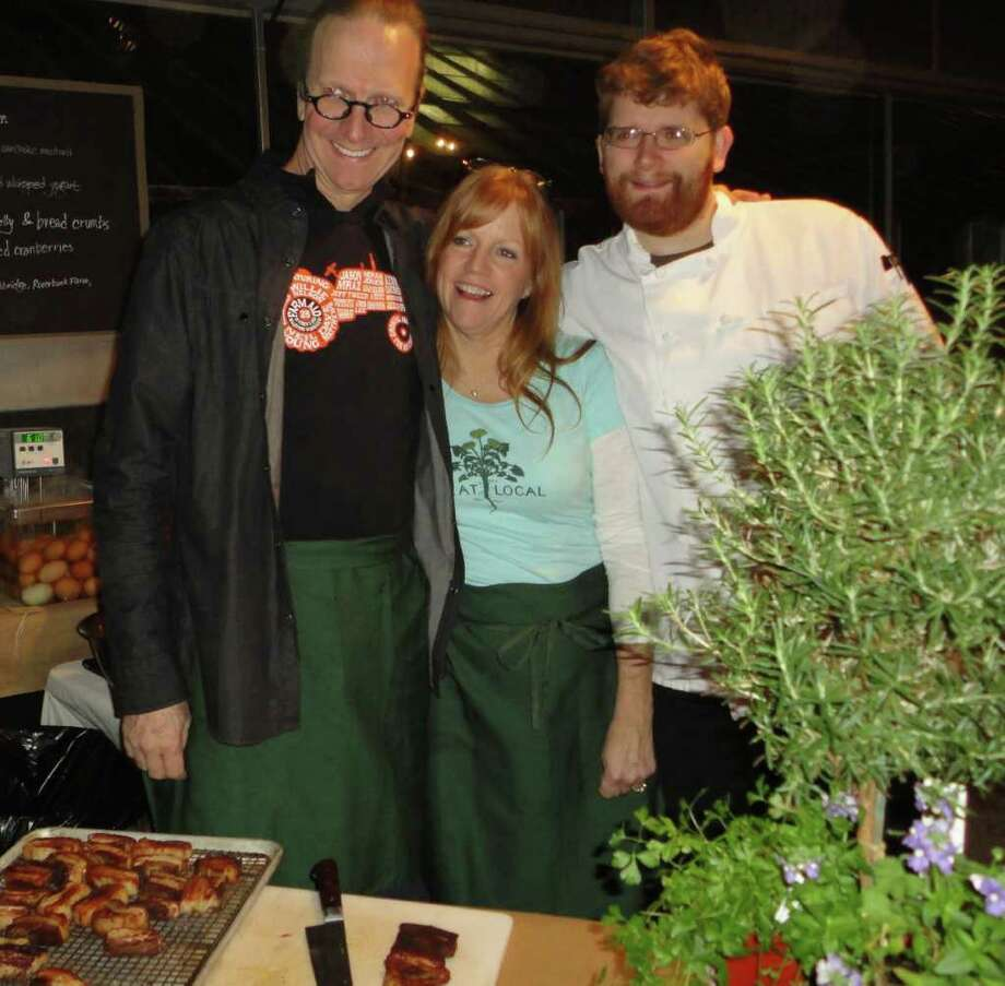 Two-time James Beard Award-winning chef and author Michel Nischan, left; his wife Lori, and Jon Vaast, chef of Nischan's restaurant the Dressing Room in Westport, take a break from preparing small plates at their station for Fork it Over, a one-night, pop-up restaraunt Saturday at the greenhouses at Gilbertie's Herb Gardens. The event, which featured five local chefs, was a fundraiser for the Westport Farmers Market. Photo: Meg Barone / Westport News freelance