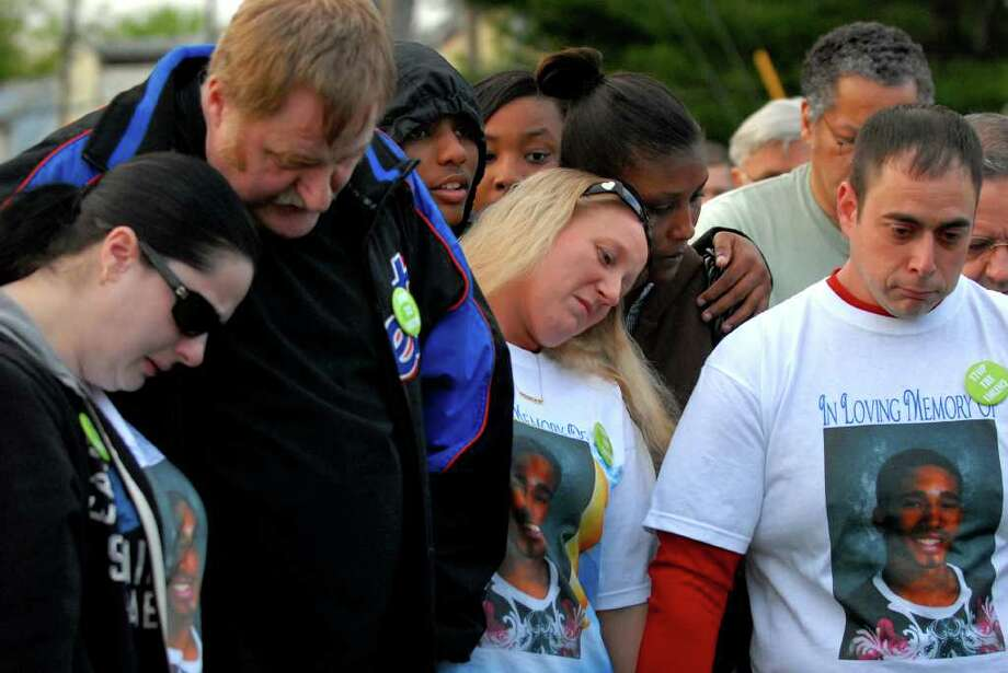 Stacey Rhodes, center, and Michael Sofer, right, mother and step-father of Tyler Rhodes, mourn his loss with Tyler's grandfather James Rhodes, left, and friend Sarah Acker for a rally held in Tyler's memory on Thursday, May 6, 2011, at Hoffman Park in Albany, N.Y. The Aim for Peace Rally follows the stabbing death of 17-year-old Tyler Rhodes at the park last week. (Cindy Schultz / Times Union archive) Photo: Cindy Schultz / 00013076A