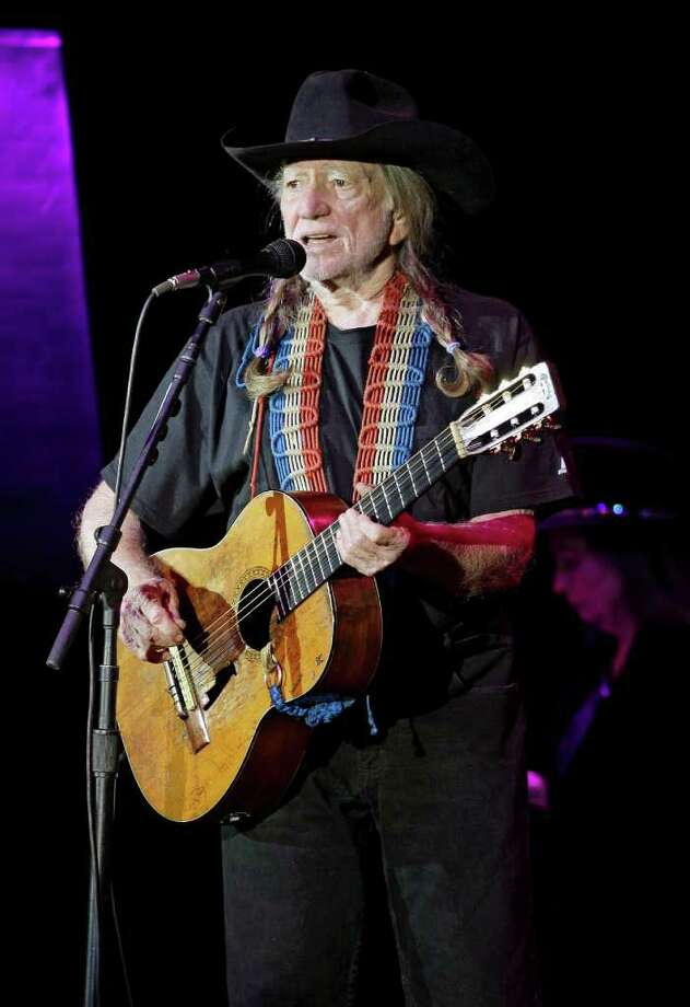 Country music icon Willie Nelson performs during a fundraising concert for U.S. Rep. Dennis Kucinich, D-Ohio, in Lorain, Ohio Sunday, Jan. 29, 2012. Redistricting has pitted Kucinich, a Cleveland Democrat, against Toledo area congresswoman Marcy Kaptur in the March primary. (AP Photo/Mark Duncan) Photo: Mark Duncan