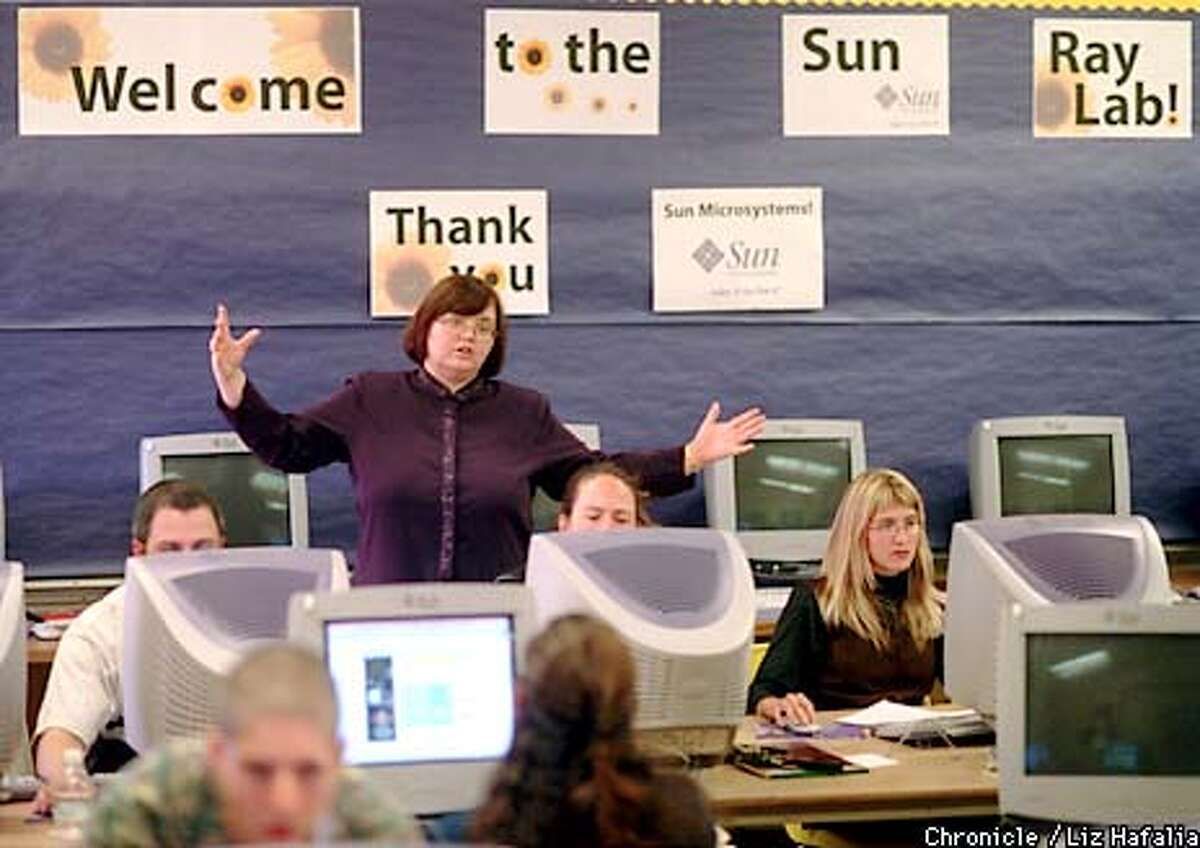 Laura Johnson of Sun Microsystems is volunteering her time to teach a word processing program to teachers at Fremont Elementary School. BY MIKE KEPKA/THE CHRONICLE