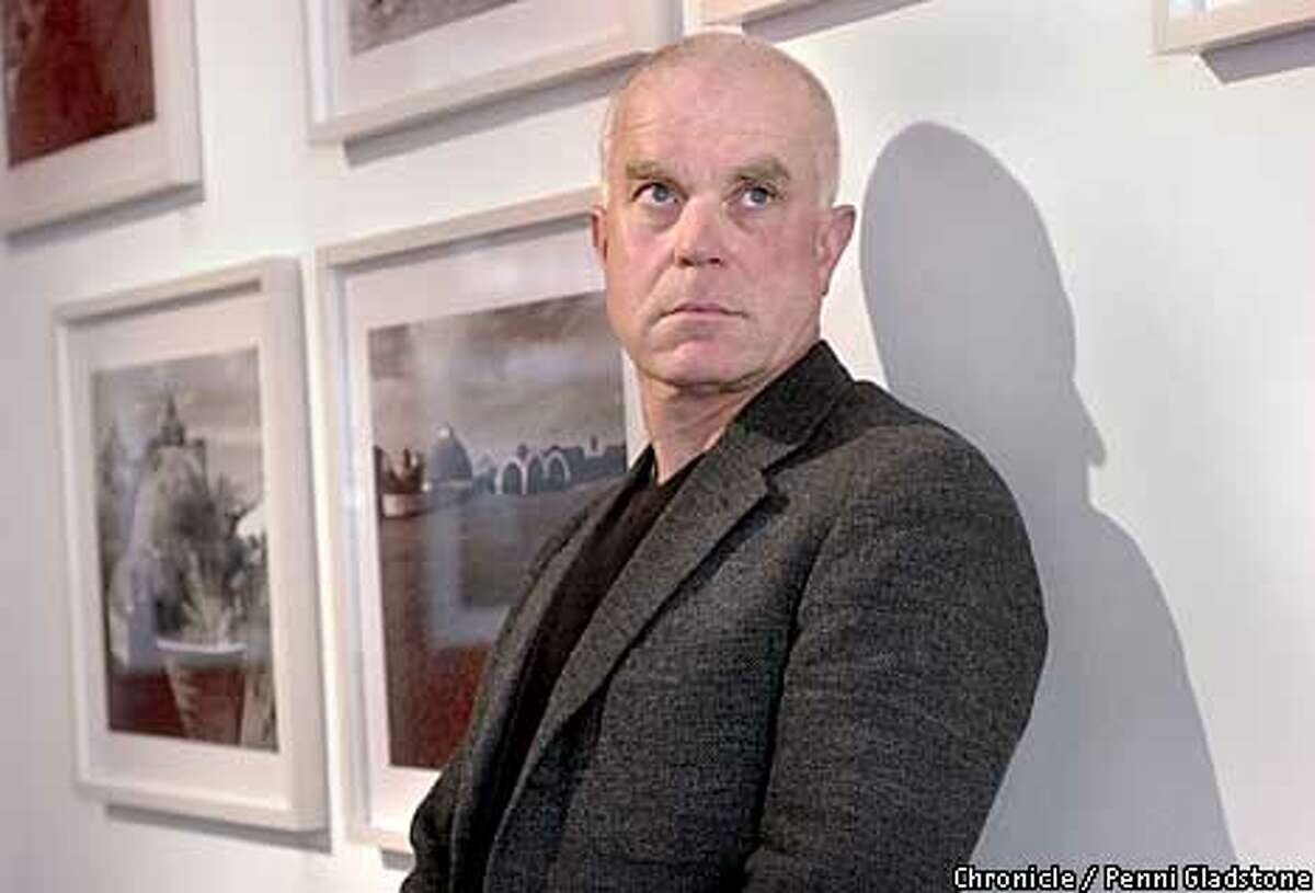 john loomis, at gallery exhibit he helped on. Loomis, architecture dean at California College of Arts and Crafts, wrote a book on neglected Cuban art schools. Book caught eye of Castro, who now wants them restored. PHOTOGRAPHY BY PENNI GLADSTONE