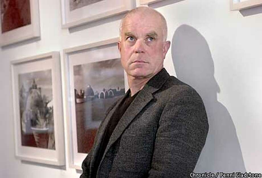 john loomis, at gallery exhibit he helped on. Loomis, architecture dean at California College of Arts and Crafts, wrote a book on neglected Cuban art schools. Book caught eye of Castro, who now wants them restored.  PHOTOGRAPHY BY PENNI GLADSTONE Photo: PENNI GLADSTONE