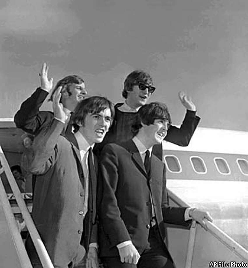 The Beatles arrived at San Francisco International Airport in August 1964 to begin an American tour at the Cow Palace. From left are Ringo Starr, George Harrison, John Lennon and Paul McCartney. Associated Press File Photo