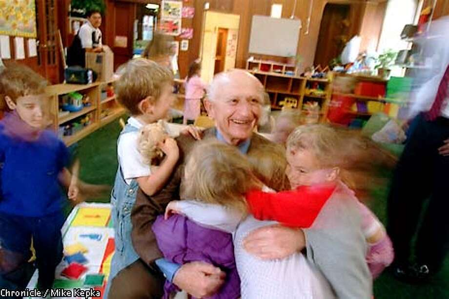 Claude Rosenberg is well received by a group of 3-year-olds who are in the day care program at The Rosenberg Early Childhood Center of JCCSF. BY MIKE KEPKA/THE CHRONICLE Photo: MIKE KEPKA