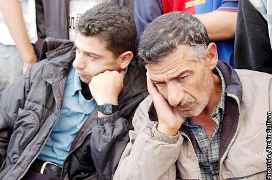 Omar Abu Selima, right, mourns the death of his fifteen year old son Ahmad Omar on Friday April 19, 2002 in Gaza City. Omar was shot and killed by Israeli soldiers on Thursday when he tried to enter the Jewish settlement of Dugit in Gaza. Photo By Justin Sullivan/For The Chronicle