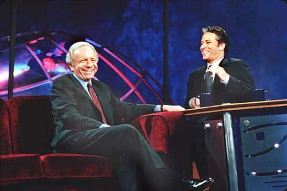 Jon Stewart, host of The Daily Show on Comedy Central, speaks with guest Senator Joe Lieberman.  (HANDOUT PHOTO) Photo: HANDOUT