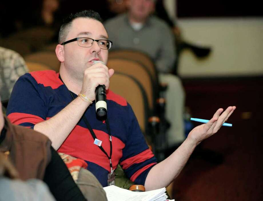 Kevin Haddad, a fourth-grade teacher at King Street Intermediate School in Danbury, makes comments Monday at a community forum held at Broadview Middle School to address proposed changes to No Child Left Behind. Photo taken Monday, January 30, 2012. Photo: Carol Kaliff / The News-Times