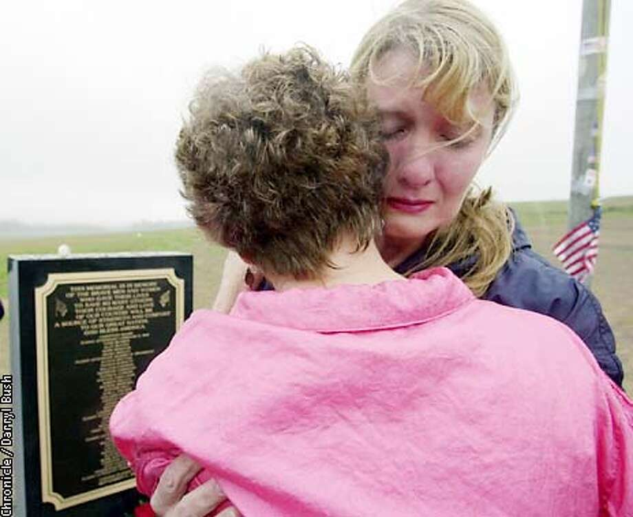 DEENA21C-C-20APR02-MT-DB Deena Burnett, right, accepts encouargement from Nancy Clark of Epson New Hampshire, left, as she visits the crash site where her husband Thomas Burnett Jr. was killed on United Flight 93 in Shanksville, PA. Chronicle Photo by Darryl Bush