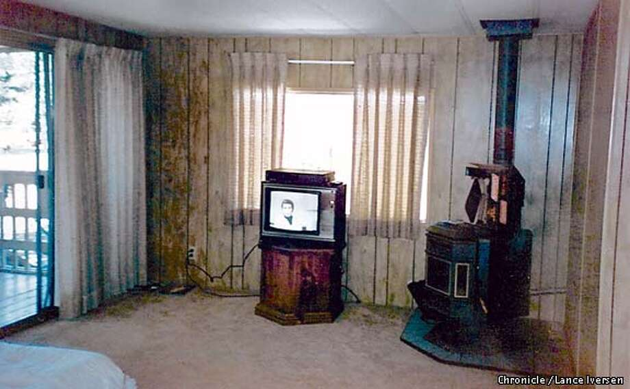 Sue Stokeld, transformed her Lake Camanche trailer into something more appealing than a cheap weekend camper. She built a new home around the old trailor changing almost everything including this typical living room found in most older trailers, with wood paneling. Photo: LANCE IVERSEN
