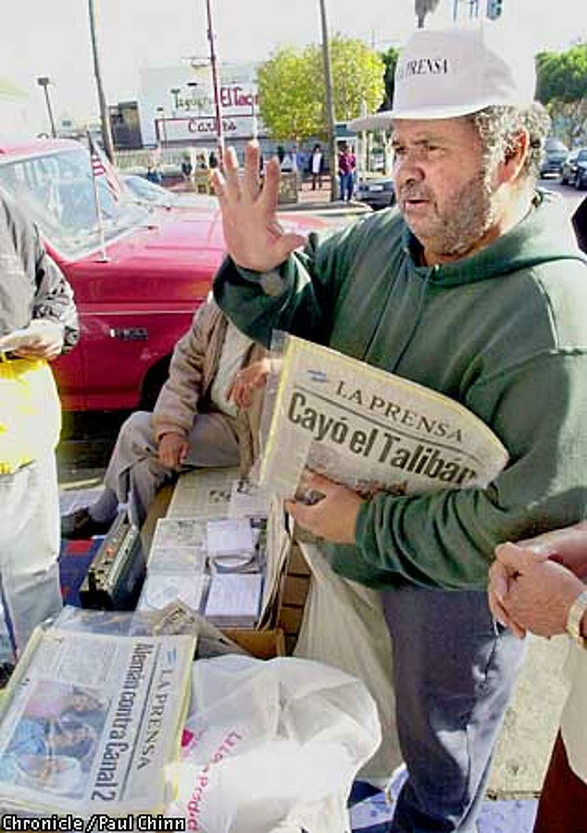 """Newspaper vendor Luis Membreno sells copies of the Nicaraguan newspaper """"La Prensa"""" at 24th and Mission Sts. Membreno and fellow Nicarguans were closely watching the presidential election in their homeland in which Enrique Bolanos defeated former president Daniel Ortega. PAUL CHINN/S.F. CHRONICLE"""