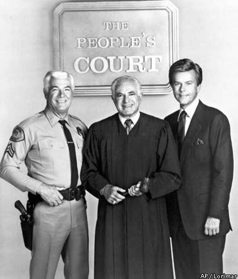 "Rusty Burrell, left, served as bailiff during the trials of Charles Manson, Patty Hearst and Caryl Chessman. He is shown in a publicity photo for ""The People's Court,"" with Judge Joseph Wapner and court reporter Doug Llewellyn, right. Lorimar photo via Associated Press"