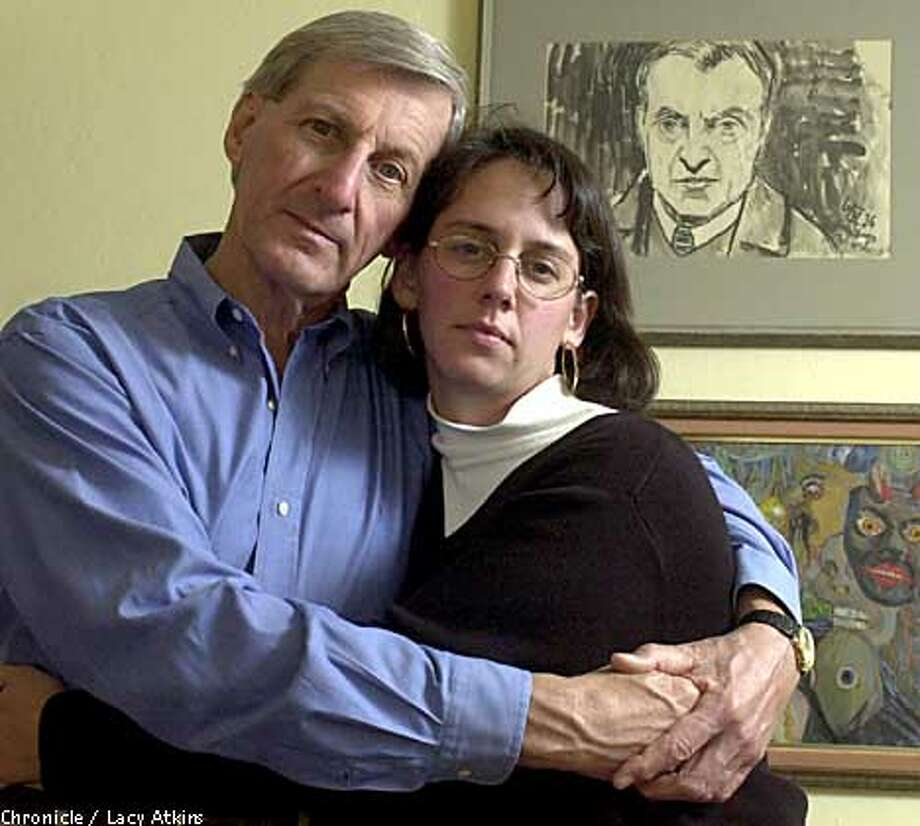 Elizabeth Rynecki -- pictured with her father, Alex -- created a Web site in honor of Moshe Rynecki,her great-great-grandfather. Moshe Rynecki, a Polish artist killed during the Holocaust, painted the self-portrait in the background. Chronicle photo by Lacy Atkins