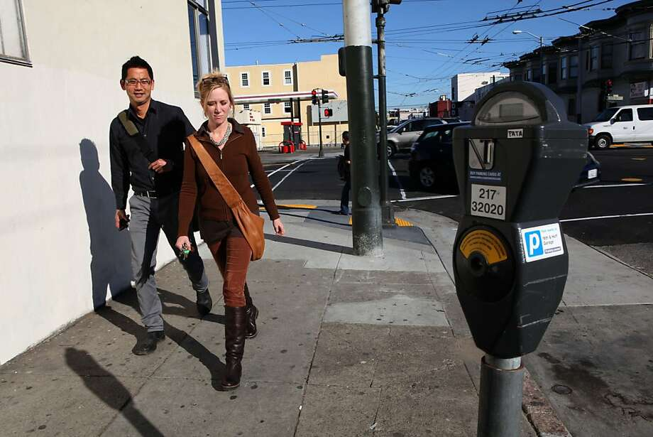 Susette Blackwell (right) and architect John Lum (left) walking on 17th street in San Francisco, Calif., on Friday, January 27, 2012.  Neighbors in the Mission, Potrero Hill and Dog Patch neighborhoods are rising up against the San Francisco Municipal Transportation Agency's plans to plant new parking meters on their streets. Photo: Liz Hafalia, The Chronicle