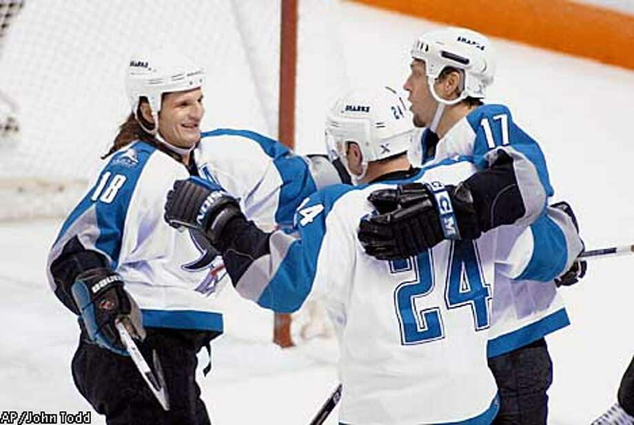 San Jose Sharks' Mike Ricci, left, and Niklas Sundstrom (24) congratulate Scott Thorton (17) after Thornton scored against the Vancouver Canucks in the first period at the San Jose Arena in San Jose, Calif., Saturday, Dec. 30, 2000. (AP Photo/John Todd) Photo: JOHN TODD