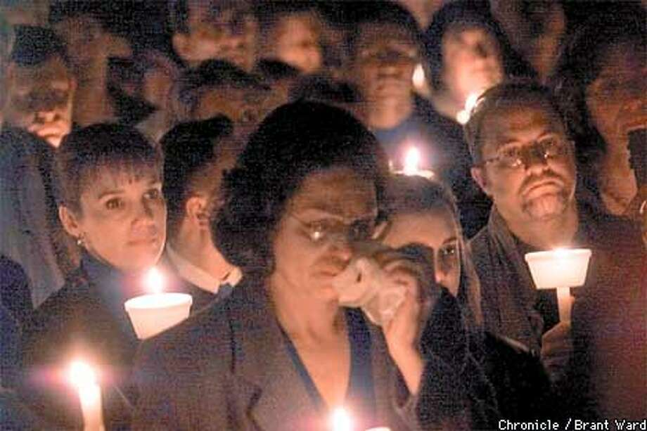 At the memorial for Luci Houston, hundreds of coworkers and friends said goodbye to the gifted photojournalist who was found dead Sunday in her car. Candles illuminated the sad faces. By Brant Ward/Chronicle Photo: BRANT WARD