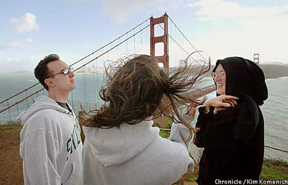 At the Golden Gate Bridge Headlands overlook we see folks who fight the wind just to see the bridge. L to R Jason Barba of Los Angeles (it was his first time), Spari (cq) Whiteley of Los Angeles, and Donna Crist of San Rafael get a blast. CHRONICLE PHOTO BY KIM KOMENICH Photo: KIM KOMENICH