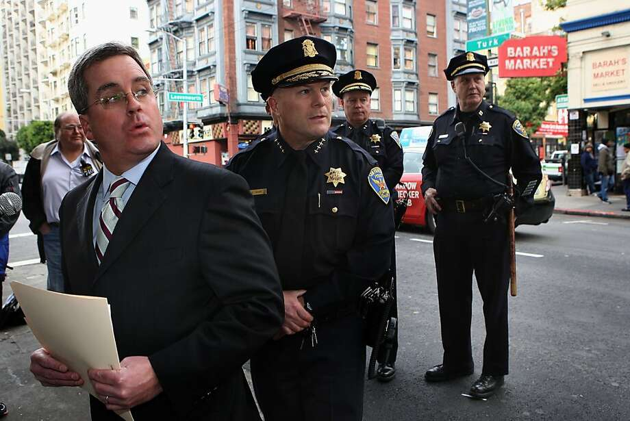 City attorney Dennis Herrera (left) joined by San Francisco Police Chief Greg Suhr (middle) announced a filing today of civil lawsuits against Barah Market (back, right), in San Francisco, Calif., on Monday, January 30, 2012.  Barah Market as well as Razan Deli have been the subject of a combined 182 calls for police service during 2011 alone, and are believed to have played a role in hundreds of of other nearby incidents requiring a police response. Photo: Liz Hafalia, The Chronicle