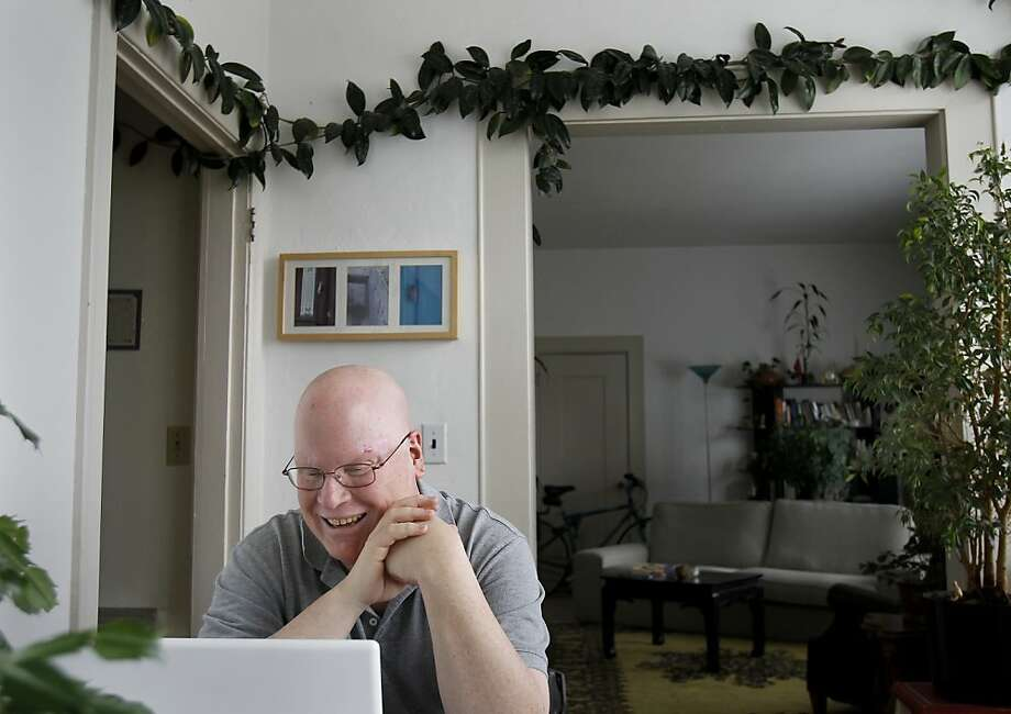Mitch Rolin loves plants in his home.  He has one houseplant wrapped around an entire room. Mitch Rolin, who suffers from basal cell carcinoma, is delighted a Genentech drug to treat the disease has been approved by the FDA.  Rolin has been using the drug as part of a trial since 2009. Photo: Brant Ward, The Chronicle