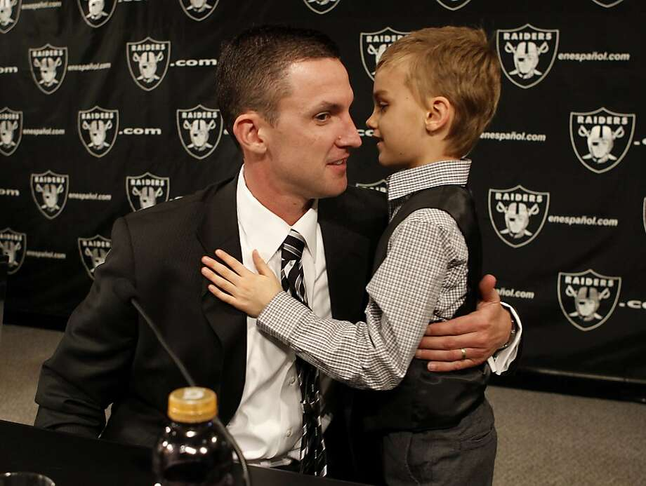 New Raider head coach Dennis Allen was embraced by his son Garrison after the press conference. The Oakland Raiders introduced their new head coach, Dennis Allen at their training facility in Alameda, Calif. Monday January 30, 2012. Photo: Brant Ward, The Chronicle