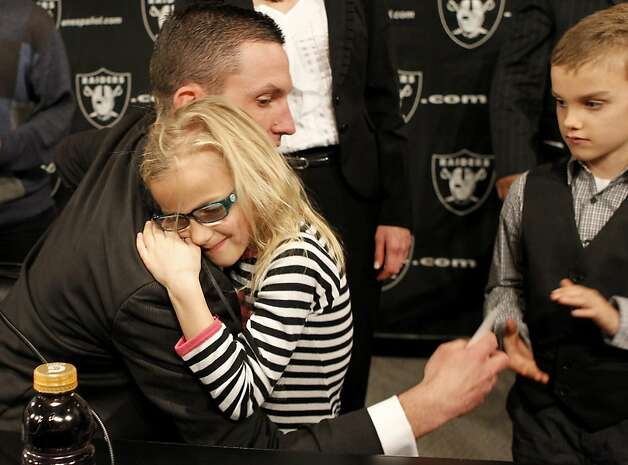 New Raider coach Dennis Allen got a hug from his daughter Leyla, 6 years, and a greeting from his son Garrison, 7 years, after the press conference. Photo: Brant Ward, The Chronicle