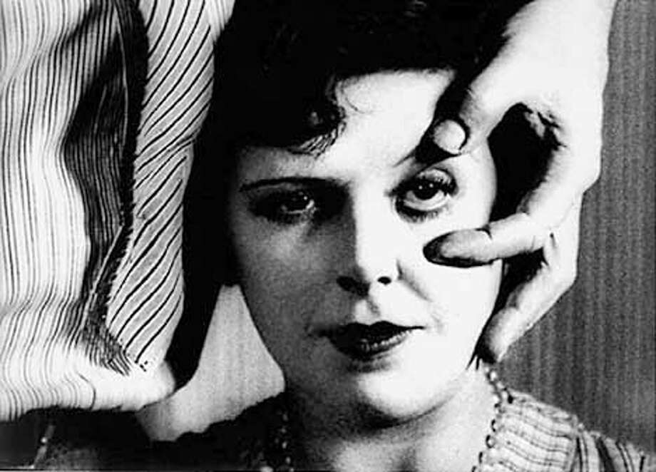 """It's a still from Bu�uel's """"Un Chien Andalou"""" 1929 (right before the famous eyeball-slicing scene!)  (HANDOUT PHOTO) Photo: HANDOUT"""