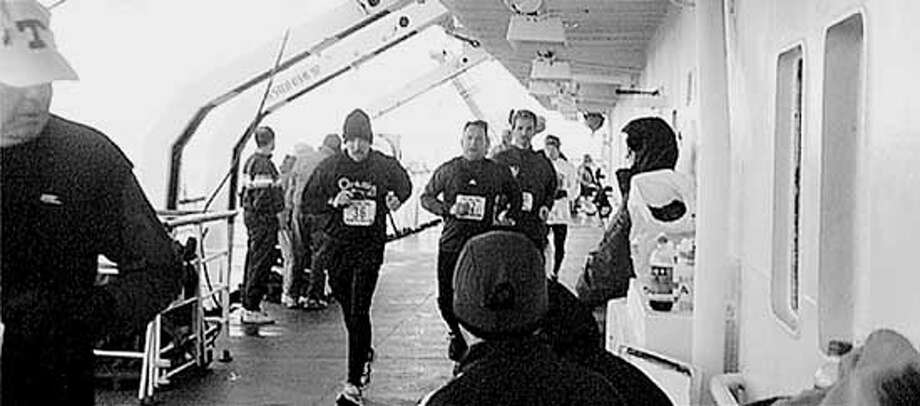 Athletes, including three Peninsula women, run their version of the Antarctic Marathon aboard the Russian research ship Lyubov Orlova. Special to the Chronicle