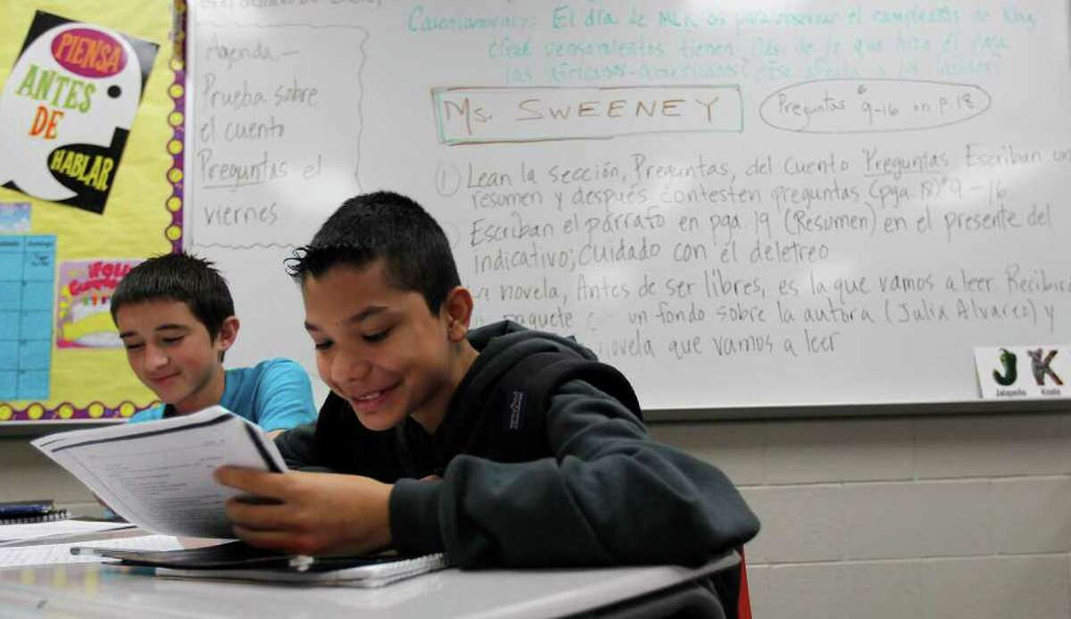 Jesse Sanchez, right, and Randy Felicia study in the Spanish for Native-Speakers class at Humble ISD's Woodcreek Middle School.