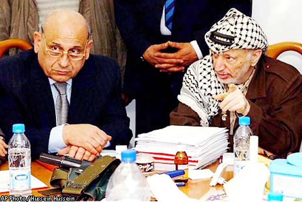 In this handout picture from the Palestinian Authority, Palestinian leader Yasser Arafat and Egyptian Foreign Minister Ahmed Maher, left, meet in Arafat's office in the West Bank town of Ramallah Friday, April 12, 2002. Maher, escorted in an Israeli military convoy, became the first Arab official to visit Arafat since Israeli troops invaded his headquarters last month. (AP Photo/Palestinian Authority, Hussein Hussein, HO)