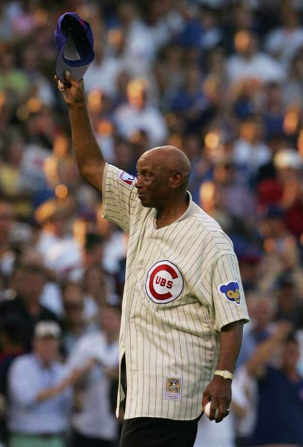 CHICAGO - OCTOBER 06:  Baseball Hall of Famer and former Chicago Cub Ernie Banks acknowledges the fans prior to throwing out the ceremonial first pitch prior to Game Three of the National League Divisional Series between the Chicago Cubs and the Arizona Diamondbacks at Wrigley Field on October 6, 2007 in Chicago, Illinois.  (Photo by Chris McGrath/Getty Images) Photo: Chris McGrath / Getty Images North America