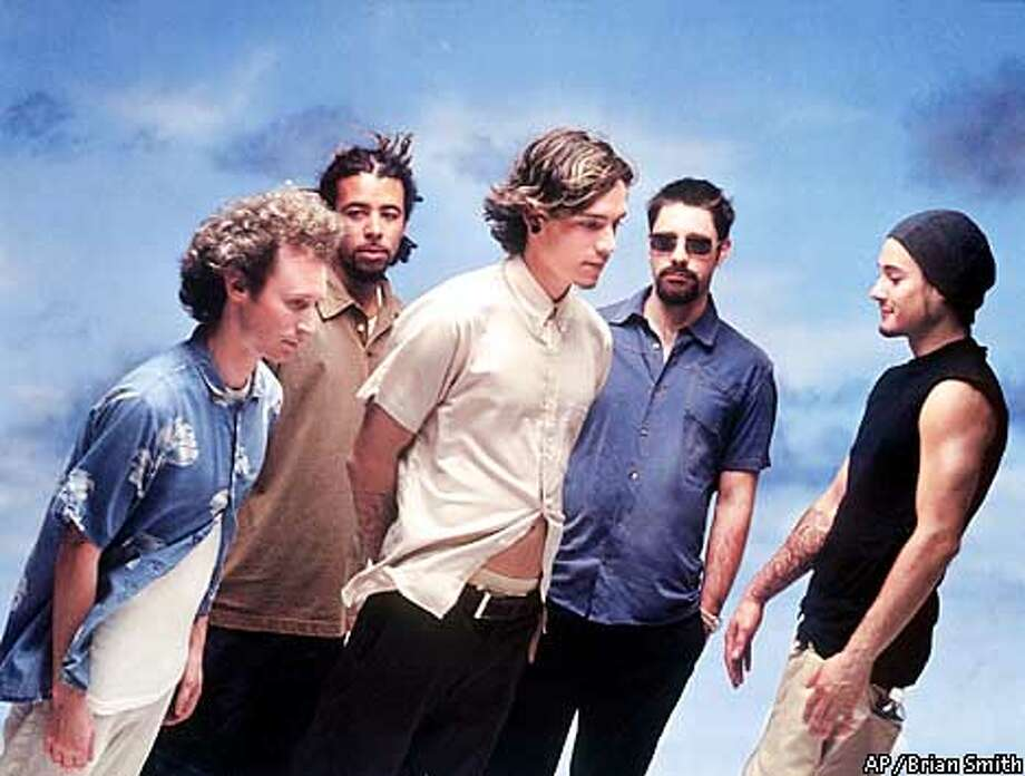 """ADVANCE FOR WEEKEND EDITIONS, NOV. 1-4--Members of the rock band Incubus Mike Einziger, left, Chris Kilmore, Brandon Boyd, Dirk Lance and Jose Pasillas II are shown in this July, 2001, publicity photo. Incubus's latest album """"Morning View"""" was released by Epic Records. (AP Photo/Brian Smith) Photo: BRIAN SMITH"""