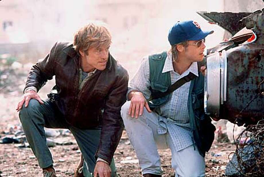 THIS IS A HANDOUT IMAGE. PLEASE VERIFY RIGHTS. Vetern CIA officer Nathan Muir (Robert Redford) and his protege Tom Bishop (Brad Pitt) take cover in a Beirut street in the Universal film Spy Game. HANDOUT.