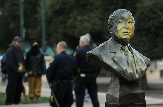A defaced bust of former city councilmember Frank Ogawa sits outside Oakland, Calif., City Hall on Sunday, Jan. 29, 2012, following an Occupy Oakland protest Saturday. After a confrontation with police, demonstrators gained entrance to City Hall where they burned an American flag, broke glass and toppled a model of City Hall. (AP Photo/Noah Berger) Photo: Noah Berger, Associated Press