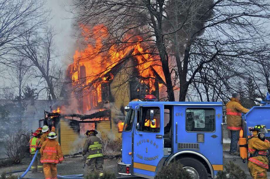 Fire crews in Columbia County fight a losing battle as flames rip through a three-story home at 10 Ark St. in the town of Philmont just before noon on Monday, Jan. 30, 2012. The home, owned by Meg Cassin, was declared a total loss. (Lance Wheeler/Special to The Times Union)