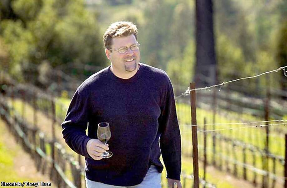 Douglas Danielak, Jade Mountain winemaker, walks in Paras Vineyards, holding a glass of 1999 Syrah in Napa. Chronicle Photo by Darryl Bush Photo: Darryl Bush