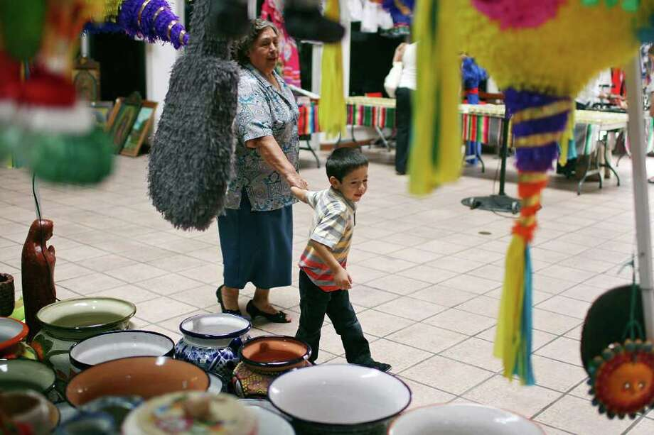 Consuelo Arreola shops with her grandson Elias Calvillo at Mercado Juarez Brownsville inside the Majestic Mall on Saturday in Brownsville. Photo: EDWARD A. ORNELAS / SAN ANTONIO EXPRESS-NEWS (NFS)