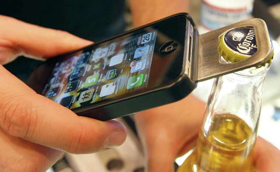 The Opena iPhone 4 case with a slide-out bottle opener in the back was demonstrated at the Macworld | iWorld 2012 conference in San Francisco last week. Apple is no longer the anchor vendor for Macworld. Photo: Tony Avelar / © 2012 Bloomberg Finance LP